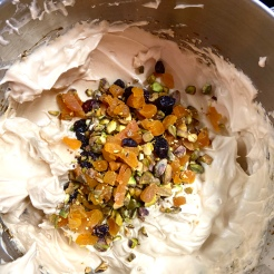 Scatter the fruits and nuts over the meringues.